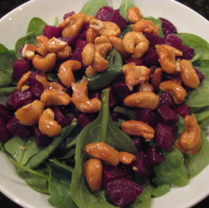 Spinach salad with candied cashews and roasted beet vinaigrette