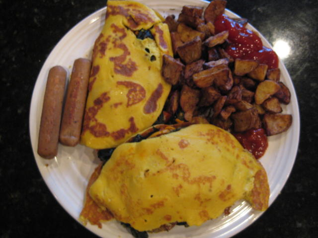 Slightly torn tofu omelettes with roasted potatoes and veggie sausage