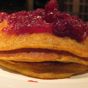 Pumpkin pancakes with cranberry sauce