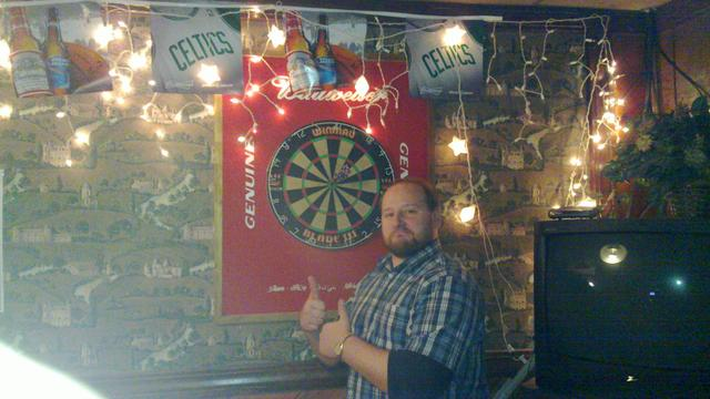 Don with 3 darts around and in the bull