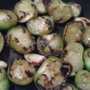 Tomatillos and garlic roasting for salsa